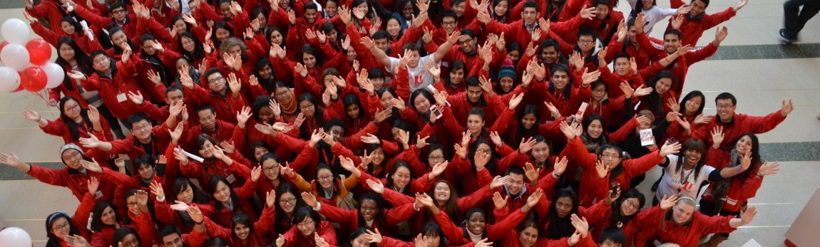 Photo of students on Red & White Day with their arms in the air
